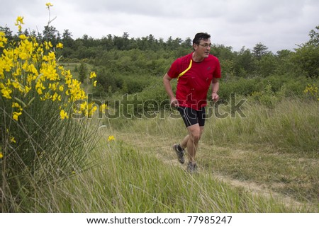 PAVIE, FRANCE - MAY 22: Male runner at the Trail of Pavie, on May 22, 2011, in Pavie, France.