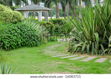 Pavilion and curving walkway in the park - stock photo