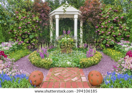 pavilion in beautiful flower garden - stock photo