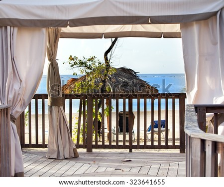 Pavilion in natural style on a beach - stock photo