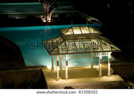 Pavilion near the pool at night - stock photo