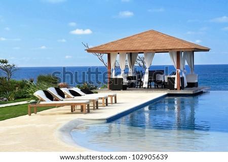 Pavilion with swimming pool near Atlantic Ocean, Dominican Republic - stock photo