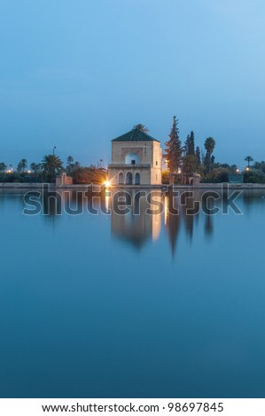 Pavillion reflection on Menara Gardens basin at Marrakech, Morocco - stock photo