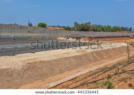 Paving a new road. - stock photo