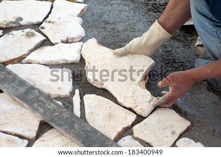 Paving a patio with natural stones  - stock photo