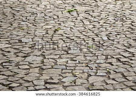Paving blocks made of asymmetrical stone - stock photo
