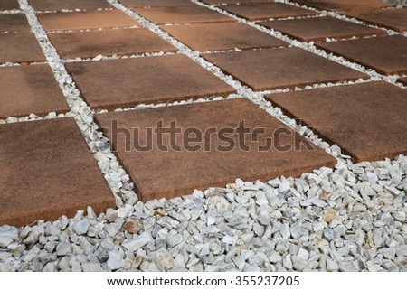 Paving Pebble Patio in rows, selective focus - stock photo