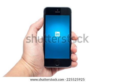 Pavlograd, Ukraine - OCTOBER 21, 2014: LinkedIn app on iphone 5S. LinkedIn is largest social network for business communication in the world - stock photo