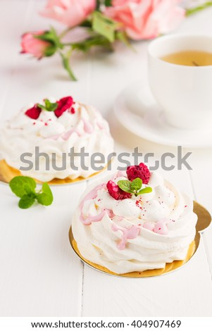 Pavlova meringue cake with  raspberries on white background. Shallow focus - stock photo