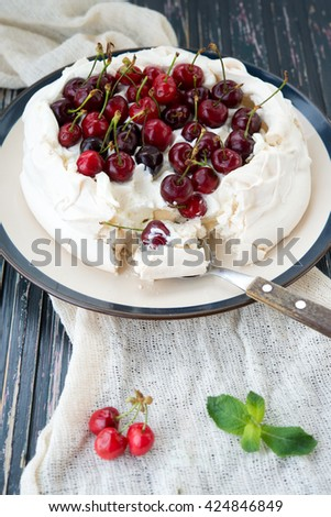 Pavlova's dessert with fresh berries, sweet cherry