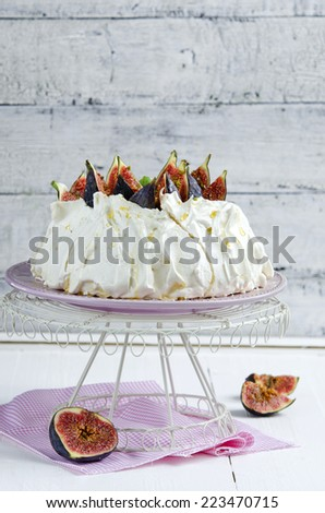 Pavlova with figs and whipped cream - stock photo