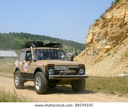 "PAVLOVKA, RUSSIA - JUNE 26: Off-road vehicle Lada Niva (No. 20) of Team ROTAS takes part at the annual trophy challenge ""23 hours of Nuriman"" on June 26, 2010 in Pavlovka, Russia."