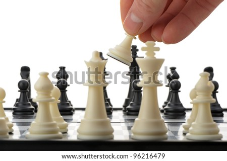 Pawn in hands over a chessboard. Selective focus - stock photo