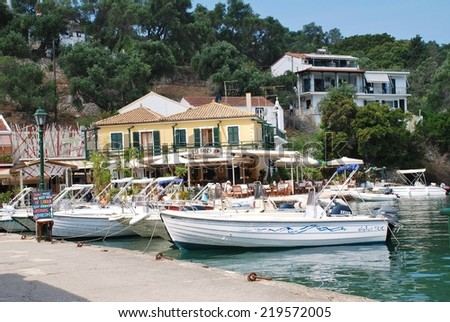 PAXOS, GREECE - JUNE 16, 2014: Boats moored in the harbour at Lakka on the Greek island of Paxos. Lakka is the Northern port of the 13 mile long Ionian island. - stock photo