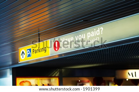 pay for parking sign at the airport - stock photo