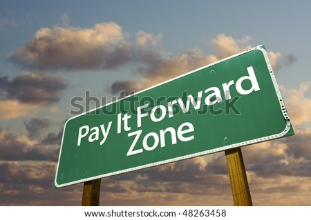 Pay It Forward Zone Green Road Sign In Front of Dramatic Clouds and Sky. - stock photo