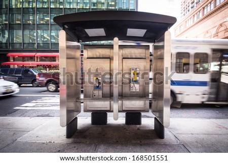 Pay phone on New York City urban street corner - stock photo