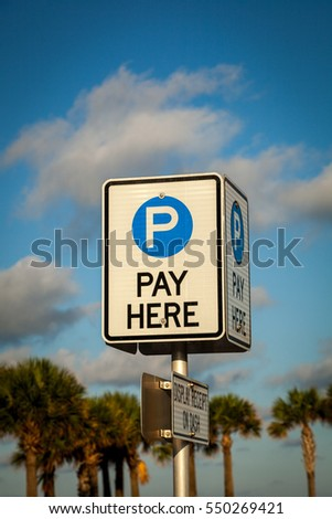 Pay sign in parking lot