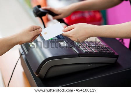 Pay with a credit card inside a convenience store. By using a barcode scanner