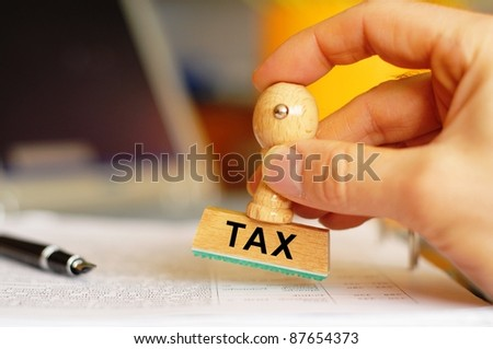 pay your taxes concept with stamp in office and copyspace - stock photo
