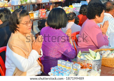 PAYAKKAPHUMPHISAI, MAHASARAKHAM - JANUARY 1 : Thai people prepare to give food offerings to a Buddhist monk at city hall plaza on January 1, 2014 in Payakkaphumphisai, Mahasarakham, Thailand.