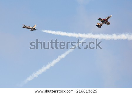 PAYERNE, SWITZERLAND - SEPTEMBER 6: airplanes of Al Fursan display Team are crossing in close distance on AIR14 airshow in Payerne, Switzerland on September 6, 2014