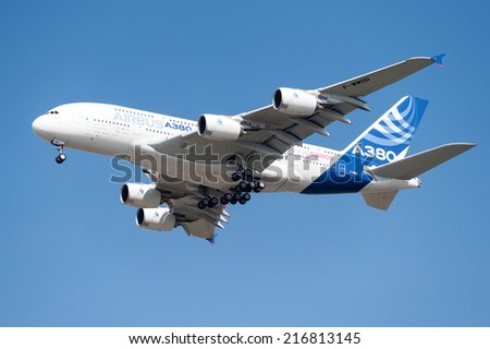 PAYERNE, SWITZERLAND - SEPTEMBER 6: Dynamic display of largest airliner currently in service Airbus A-380 on AIR14 airshow in Payerne, Switzerland on September 6, 2014 - stock photo
