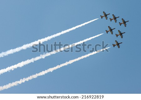 PAYERNE, SWITZERLAND - SEPTEMBER 7: Flight of Al Fursan aerobatic team from UAE in close formation on AIR14 airshow in Payerne, Switzerland on September 7, 2014