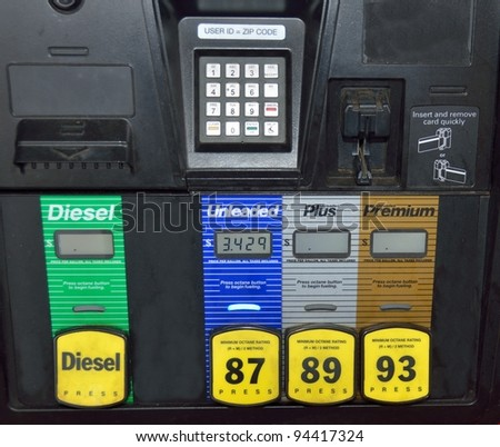 Paying at the fuel pump at local gas station rural Georgia, USA. - stock photo