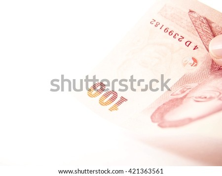 Paying by banknote, thai baht money, value 100 baht on white background  - stock photo