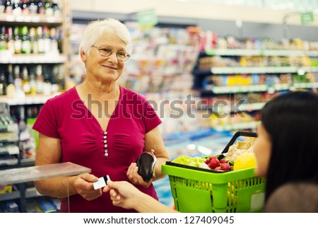 Paying credit card for purchases - stock photo
