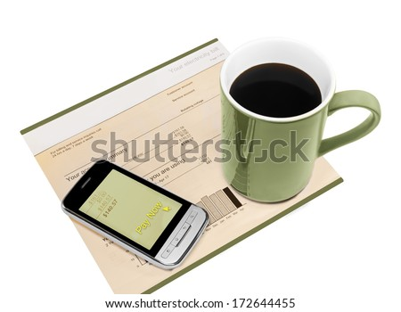 "Paying electric bill online, quick easy mobile payment with smart phone. ""Pay now"" link on screen, paper account invoice, coffee cup. Business mobility concept. Isolated on a white background."