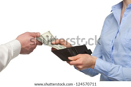 Paying money from a wallet - closeup shot of hands - stock photo