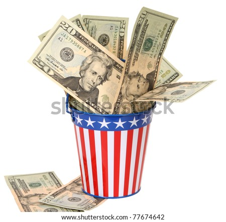Paying Uncle Sam -- Twenty-dollar bills stuffed into a stars-and-stripes decorated pail. Concept of American money going to the government in taxes. - stock photo