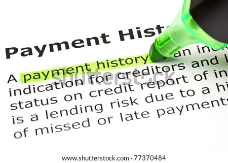 Payment history highlighted in green with felt tip pen. - stock photo