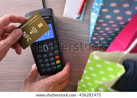 Payment in a trade with nfc system and contactless card. Top view - stock photo