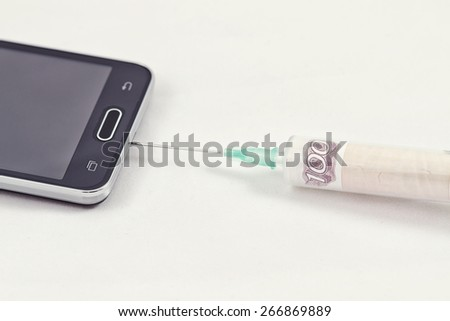 payment provider. Depositing a mobile phone to pay for online games - stock photo