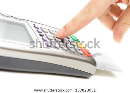 Payment terminal - a finger entering the PIN code - stock photo