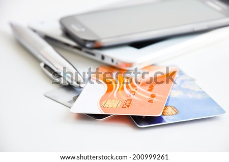 Payment via smartphone or mobile device - stock photo