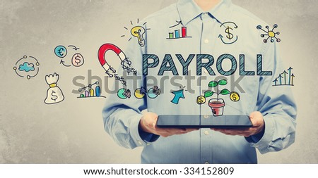 Payroll concept with young man holding a tablet computer  - stock photo