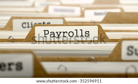 Payrolls Concept. Word on Folder Register of Card Index. Selective Focus. - stock photo