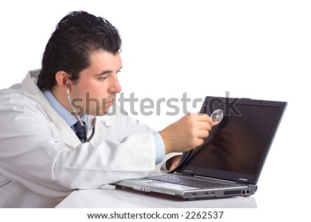 PC doctor examining a laptop computer against white background - stock photo