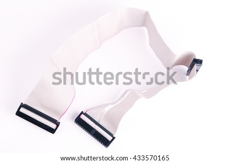 PC hard drives SATA cable. Shallow DOF. Isolated on white background. IDE connectors and ribbon cables for hard drive on PC computer, isolated, red, grey, black, large detailed macro closeup - stock photo
