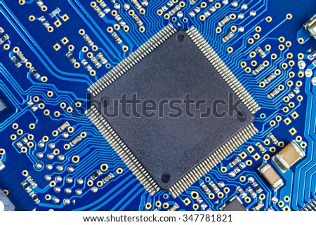 PCB computer board capacitor macro background - stock photo