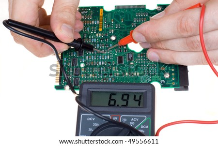PCB diagnostics and measurement by means of a multimeter - stock photo