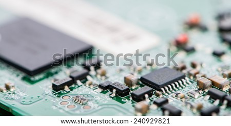 PCB (Printed Circuit Board) with different components - stock photo
