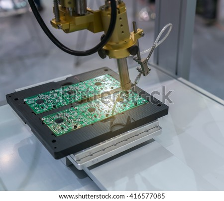 PCB Processing on CNC machine working in factory - stock photo
