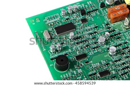 PCB with chips, buzzer, capacitor, transistor, crystal and other components, selective focused. - stock photo