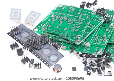 PCBs with different electronic components isolated on white background - stock photo