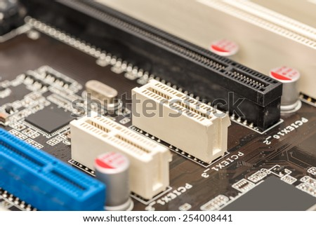 PCI Connector Slots On Computer Motherboard - stock photo